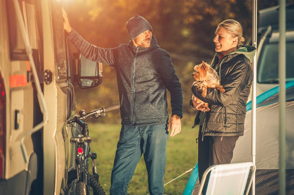 Couple in caravan park with dog